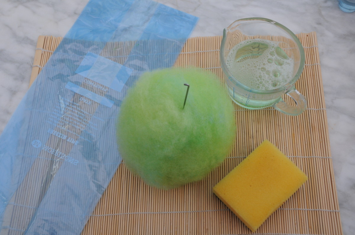Freezer bag, sponge, felting needle and hot soapy water.