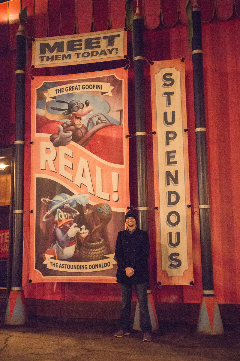 My husband with one of the posters in Storybook Circus Fantasyland in Magic Kingdom.