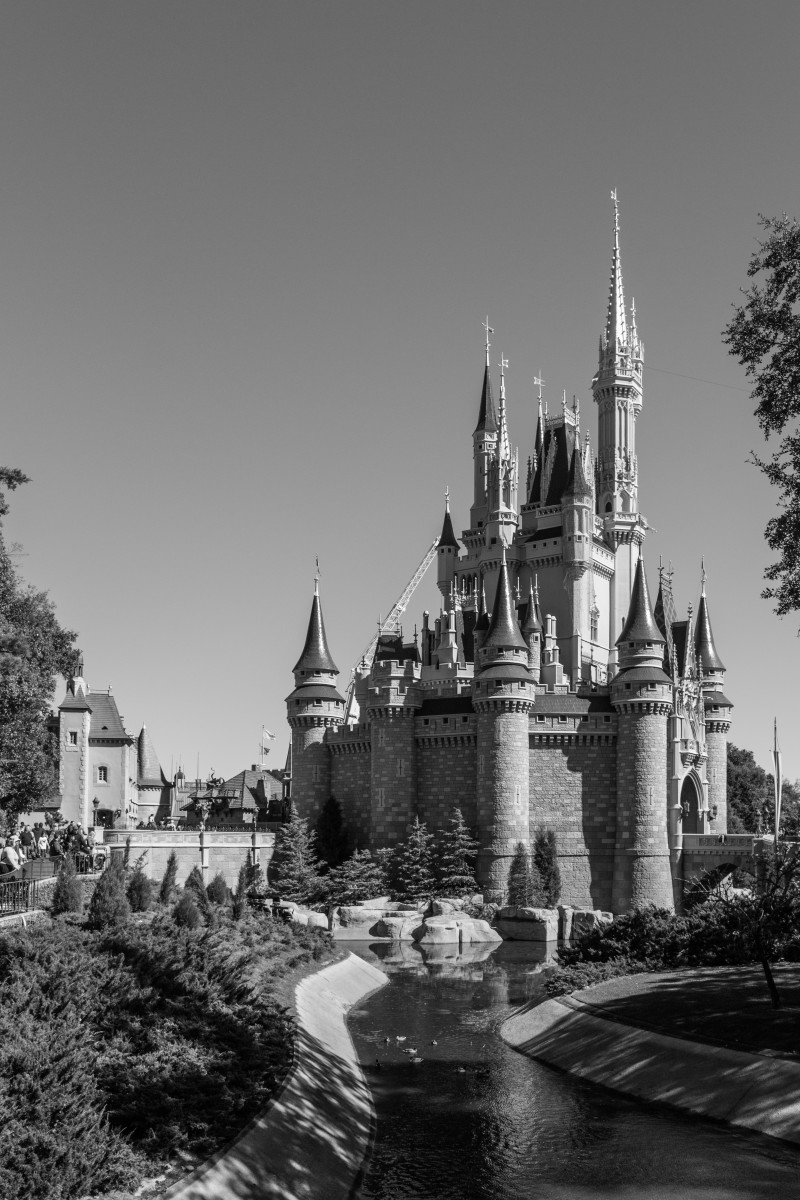 The iconic Cinderella Castle in black and white.