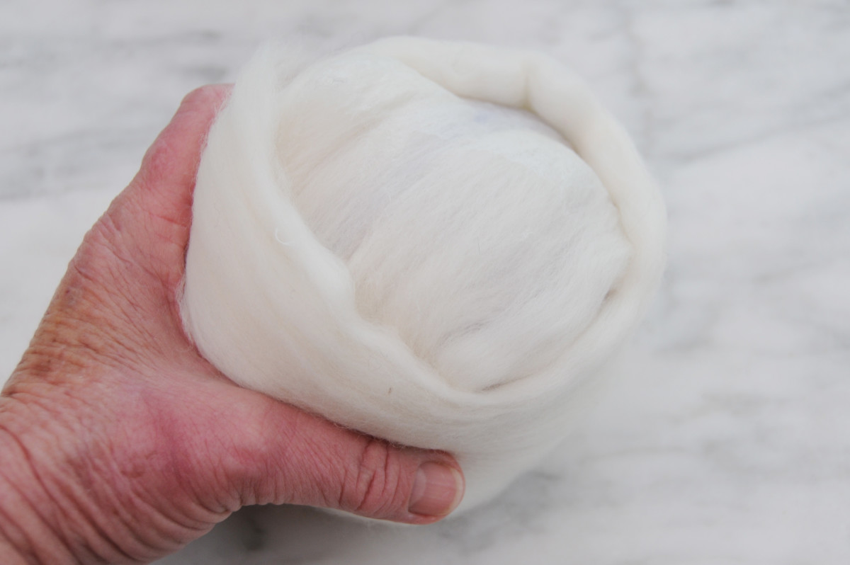 Cover in White Roving until the ball is evenly covered, smooth out the layers carefully.