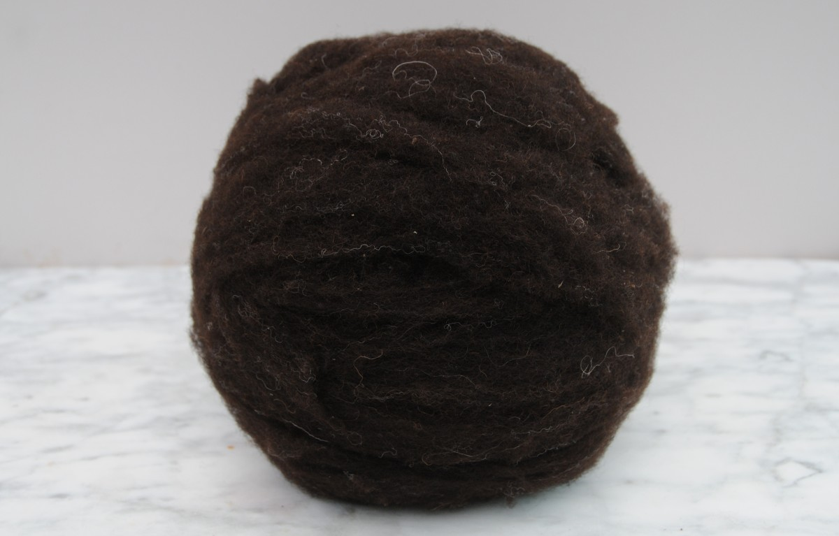 The second layer of wool covering the ball