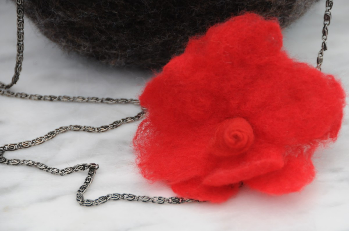 A removable felt flower, onecould be attached to the shoulder bag