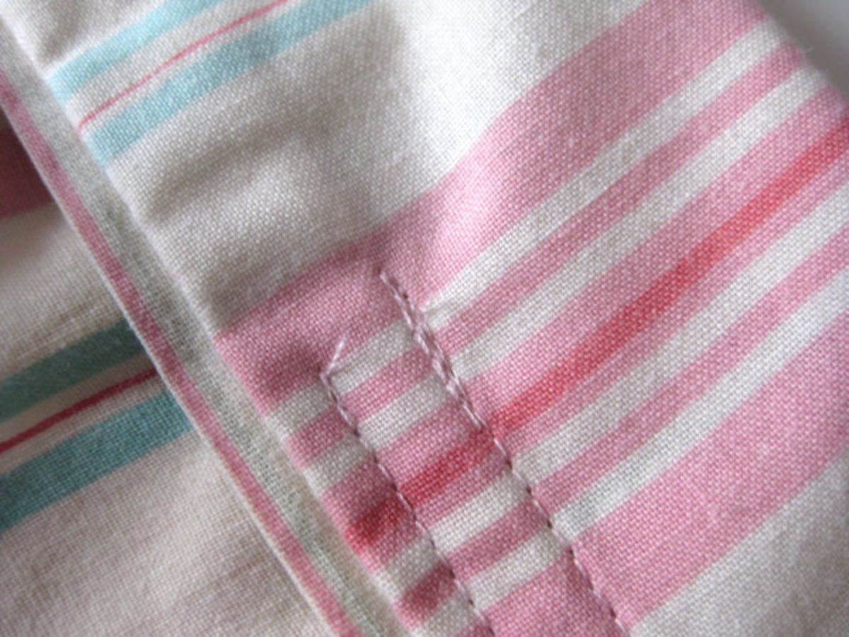 An example showing the forward/reverse stitching near the opening (where the vertical pins were).