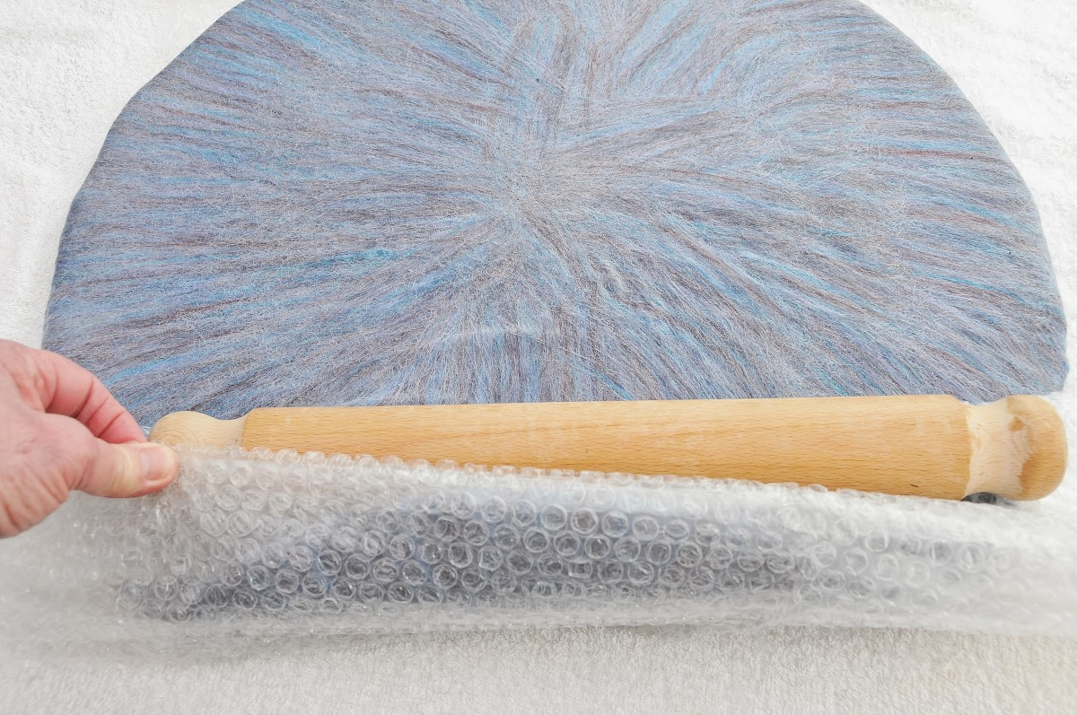 Roll in bubble wrap, bubble side down using a wooden rolling pin or use a bamboo mat