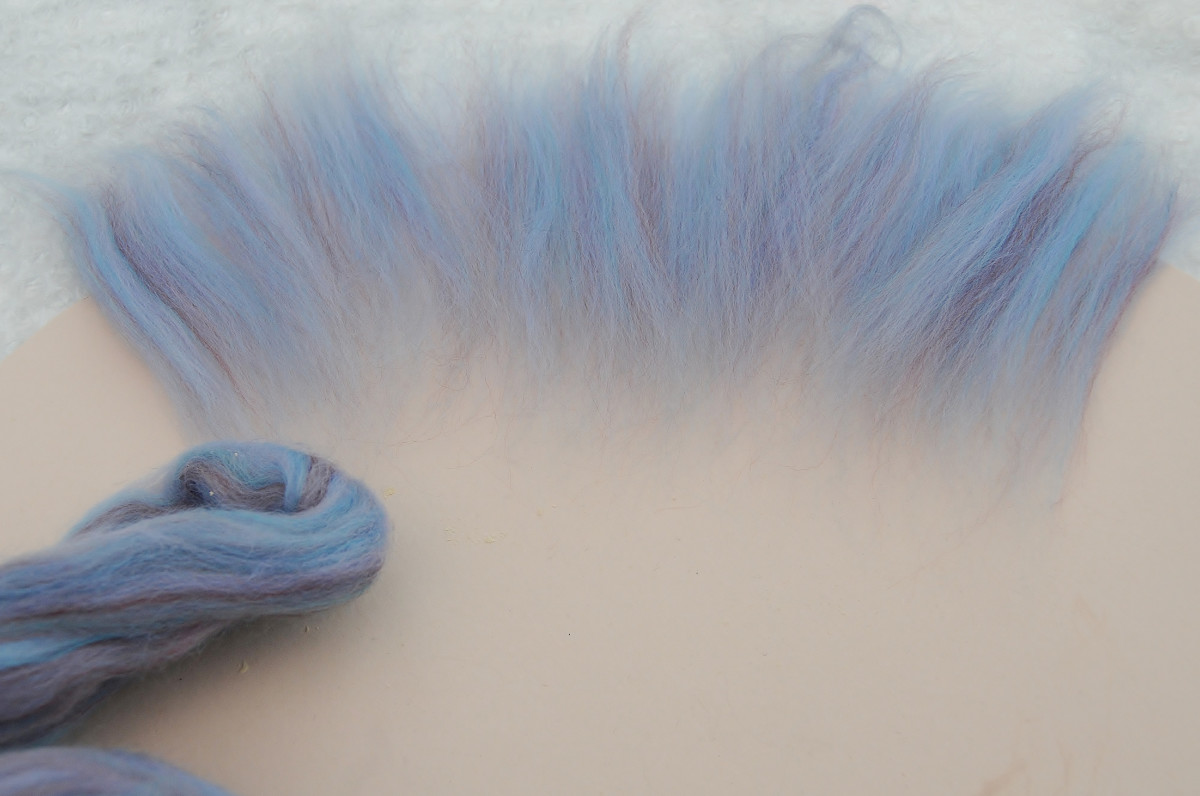 Place a circular layer of wool roving onto the resist shape