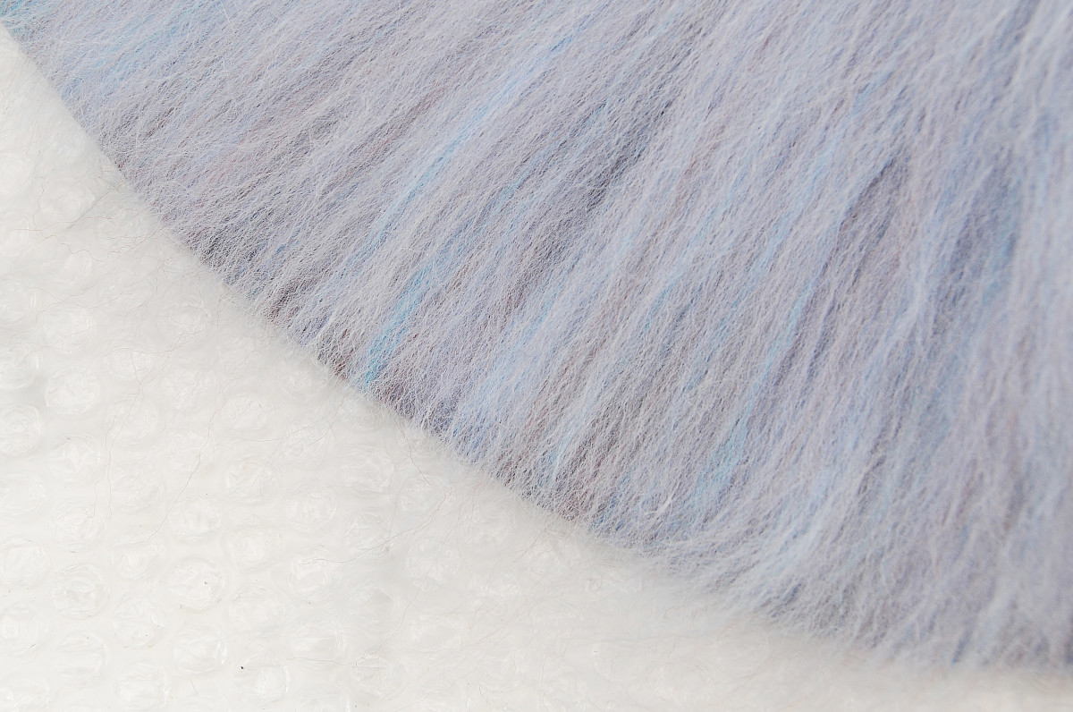 Image shows the final layer of wool fibers being taken to the edge but not over it.