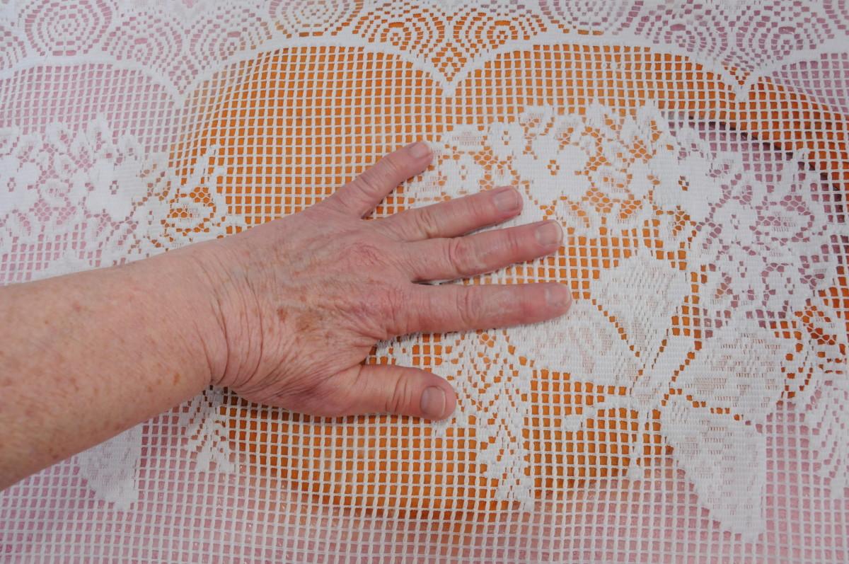 Press down using your hands to flatten the fibers