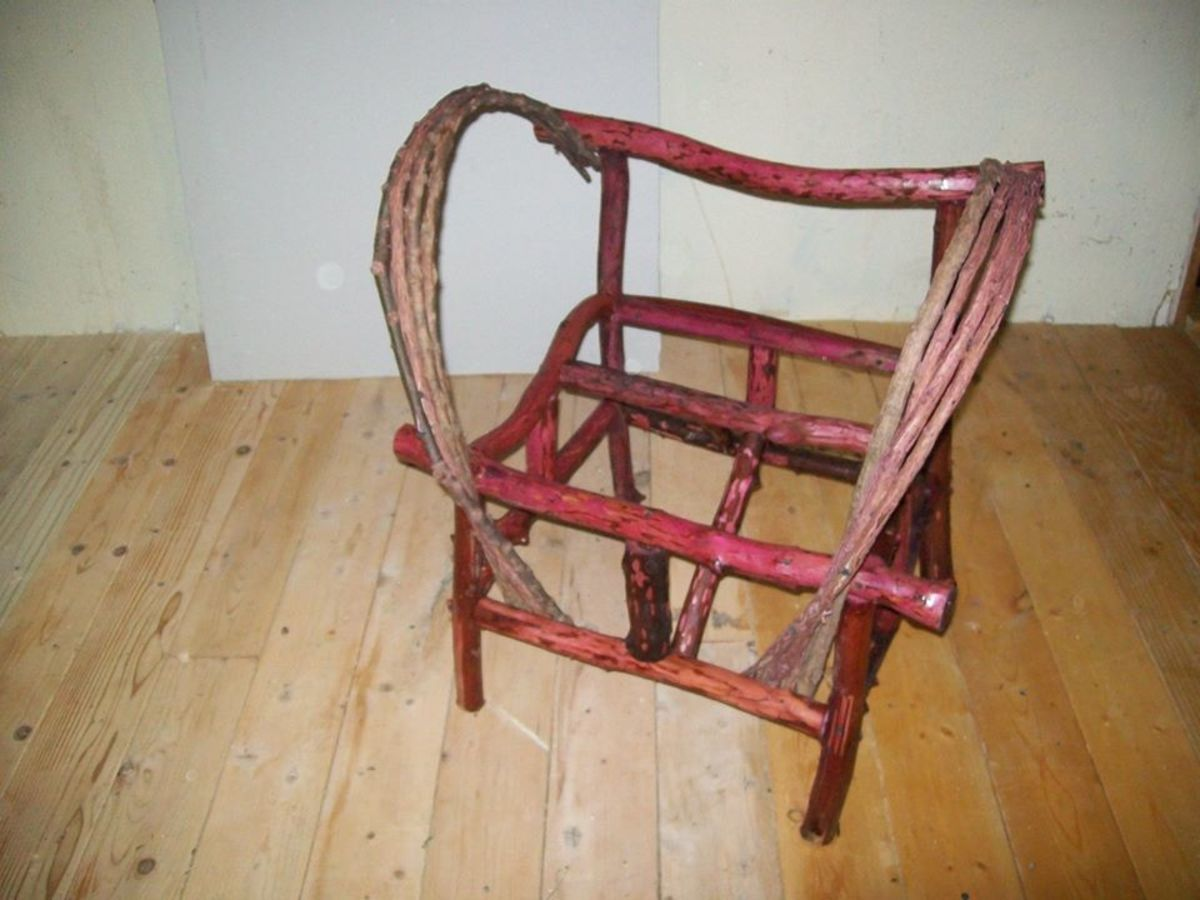 Chair frame with back support and arm benders in place. The front slanted brace can be seen in this picture.