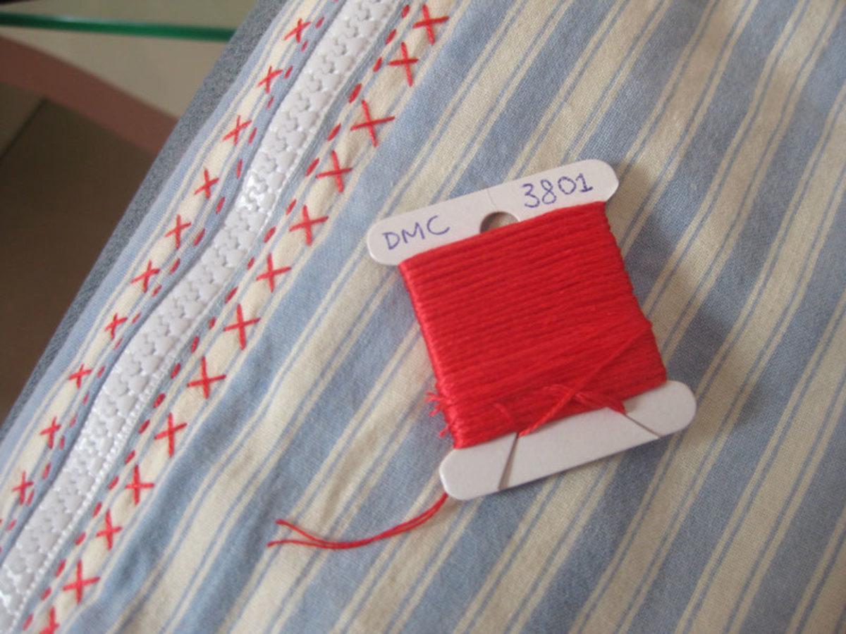 DMC embroidery thread. Usually it comes as a skein, instead of wrapped on a card like this. You can wrap it if you want to - up to you!