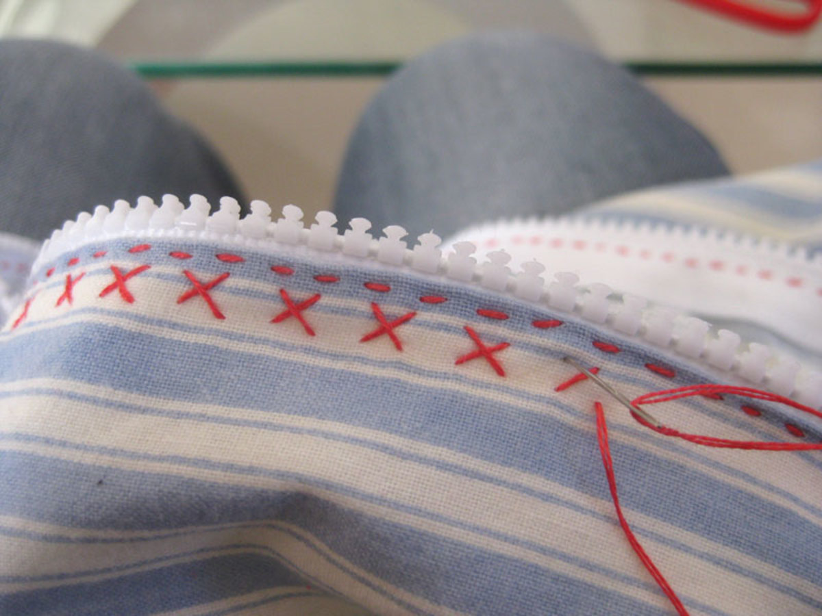 Continue cross stitching all of the way around the pillowcase.