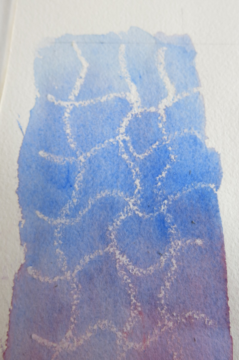 Simple marks with a white crayon, grease pencil or candle can create beautiful results in watercolor.