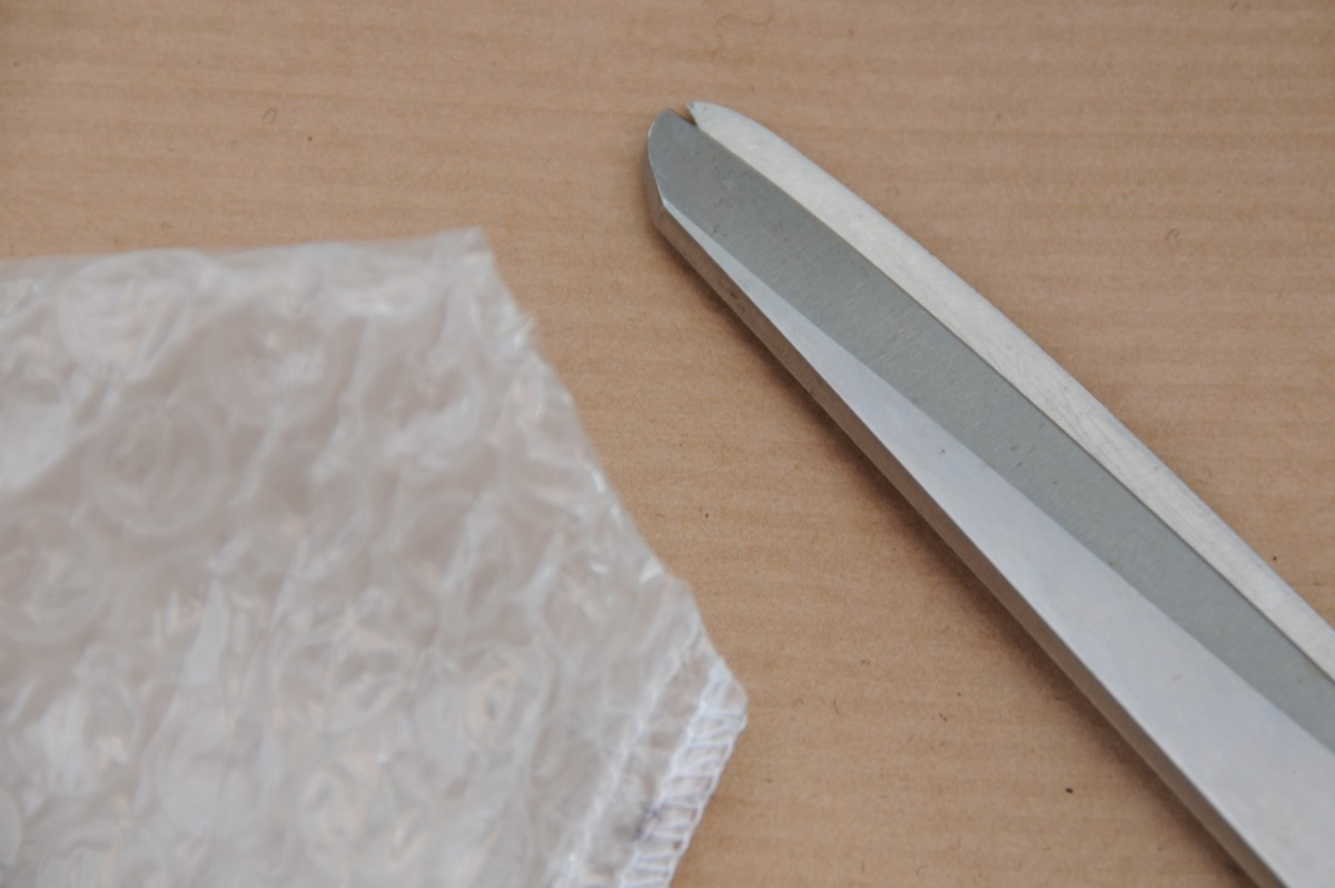 Cut off the bottom of the bubble-wrap liner as shown