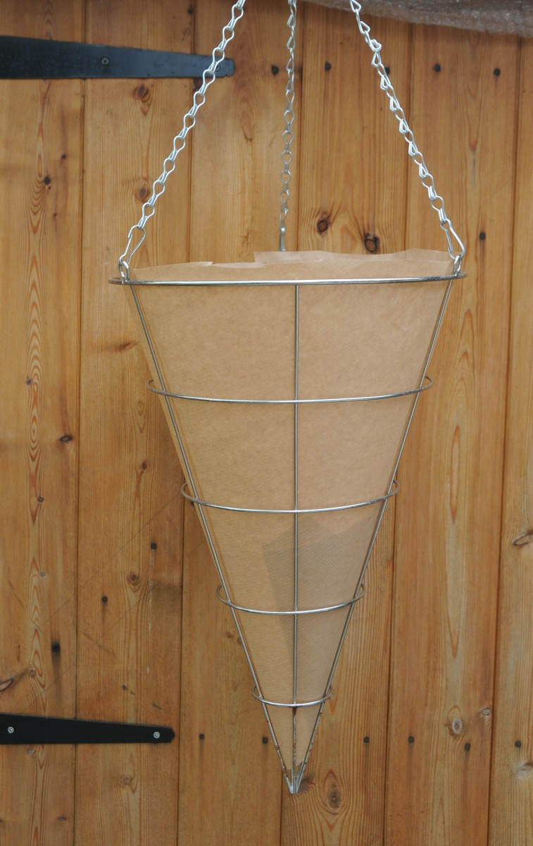 A cone of brown paper inside the metal hanging basket