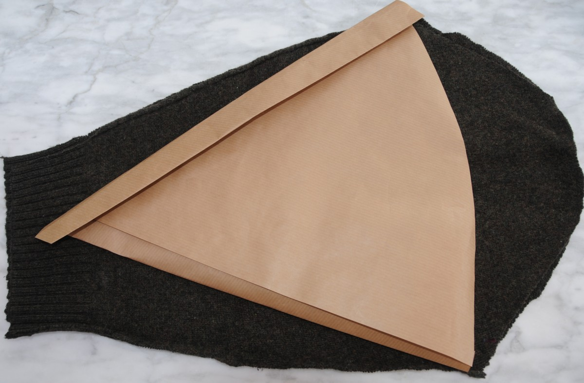 Fold over 1 inch on both sides of the paper pattern