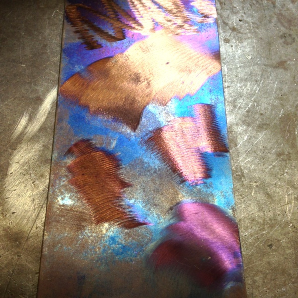 Steel with a bright heat colored patina
