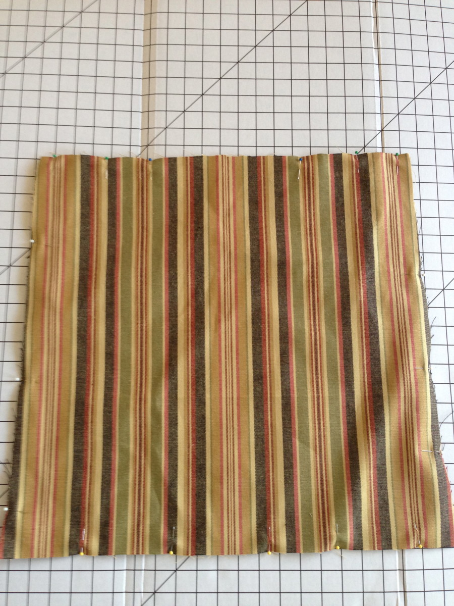 Stitch top and bottom pieces together, right sides together, with ties sandwiched inside. Leave an opening in the back edge for turning right-side-out.