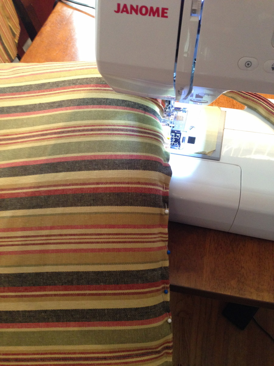 Since my cushions were rather thin, I decided to stitch the cover closed on the machine.  It took a bit of wrestling and a lot of pins, so if you don't want to do this you can sew the opening closed by hand using a slip stitch.