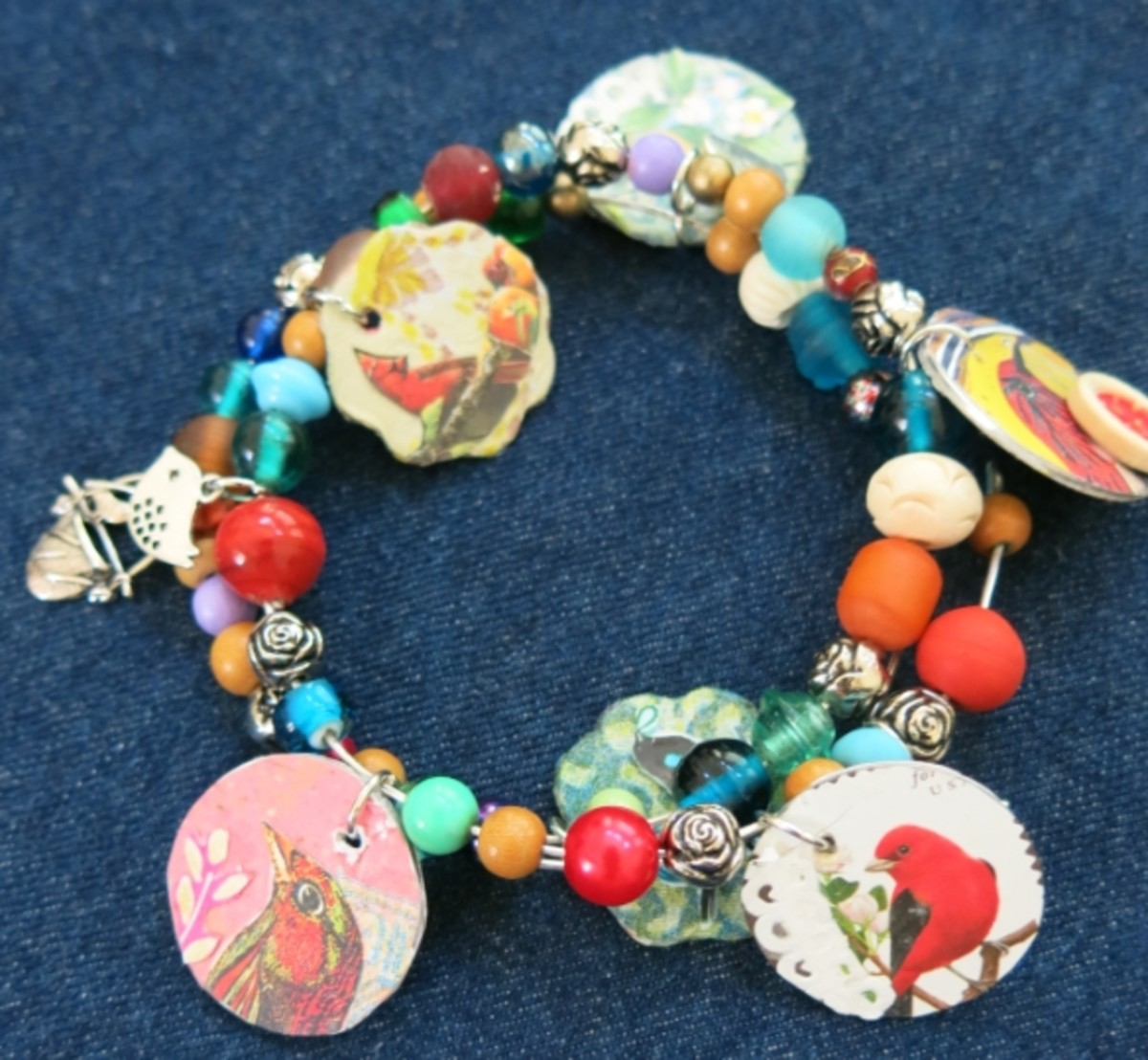 Use memory wire and beads to make a bracelet with your handmade charms