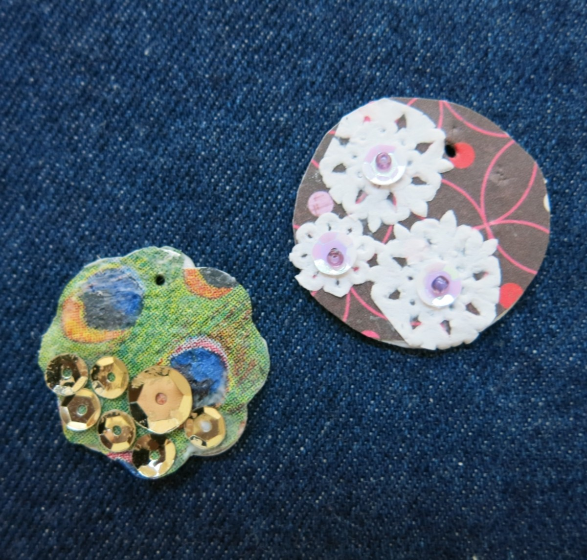 Use wrapping paper, stickers, postage stamps, paper doilies, buttons, and sequin to decorate your charms