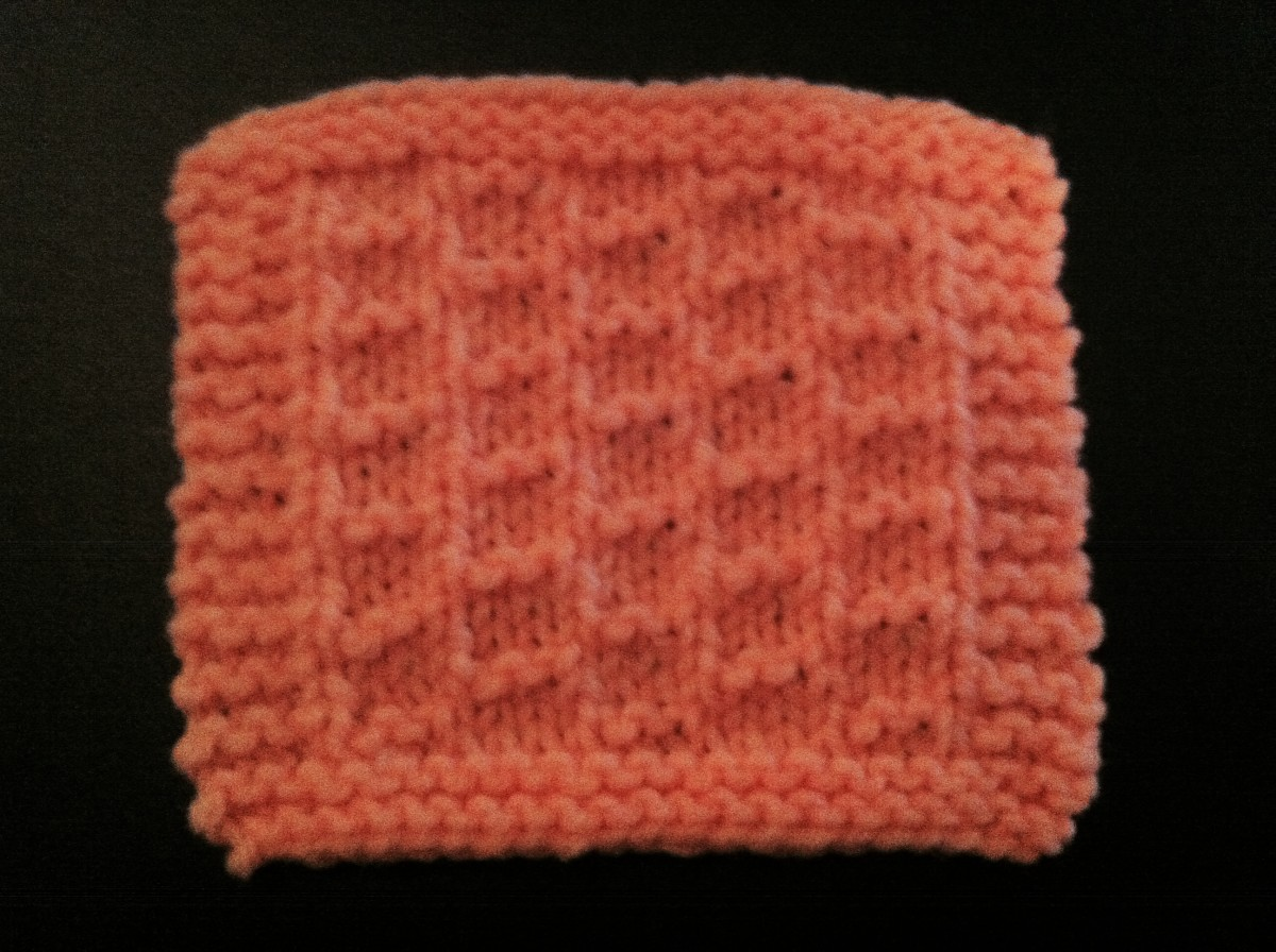One of the coasters in the knitted coaster set called Welded Laddered Love.