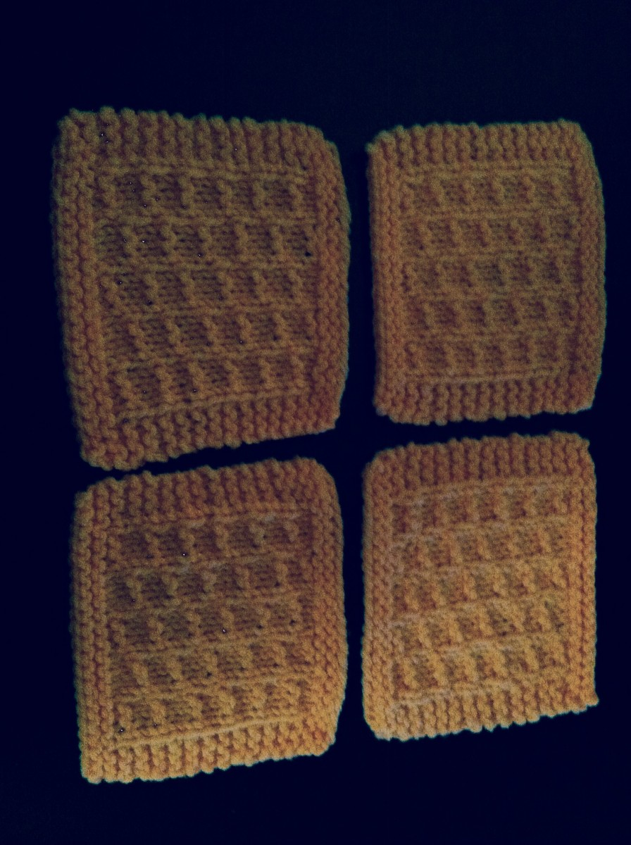 This is an example of a set of four coasters made with this free knitting pattern and ready to be put to use!