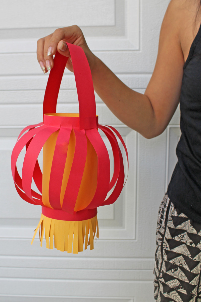 The strips in this Chinese paper lantern have a round effect because the top and bottom were folded, which allowed the strips to balloon out.