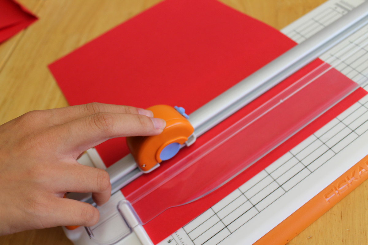Use a paper trimmer like this to make cuts in the center of the paper.