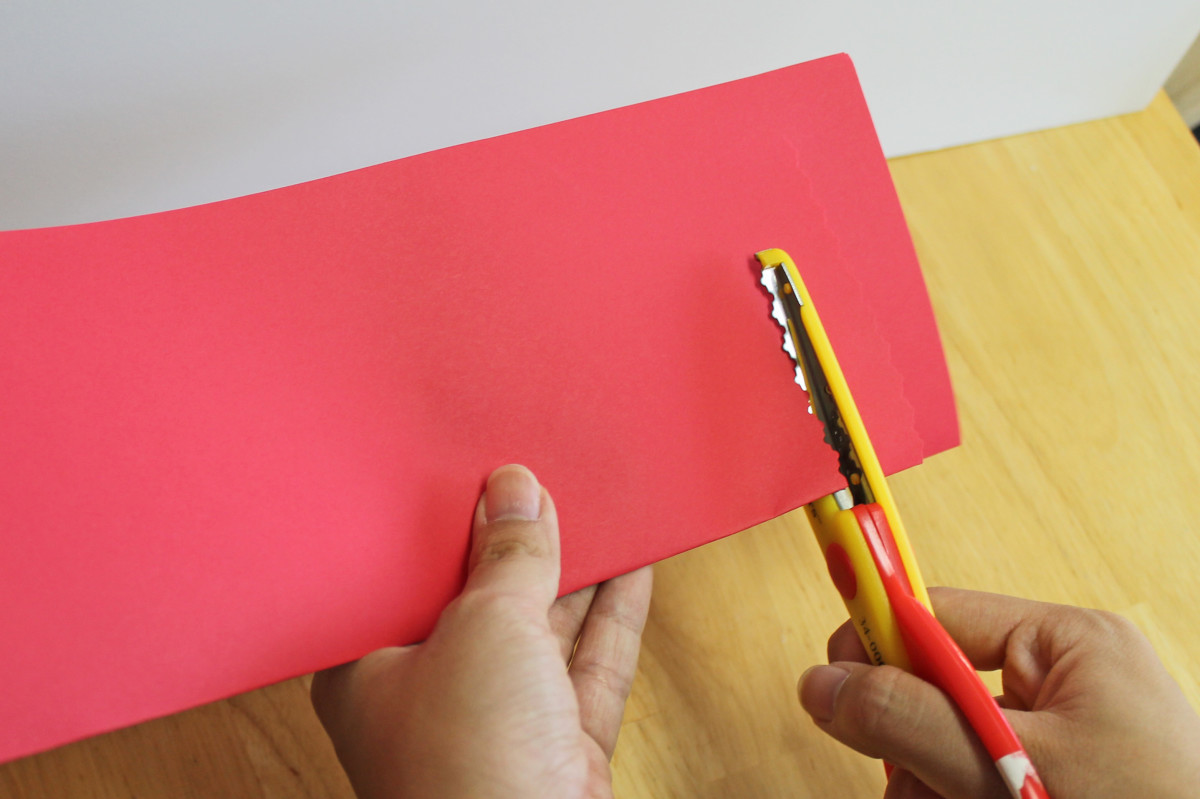 Do the same kind of cuts you did for the simple Chinese lantern, but use the special edging scissors instead.