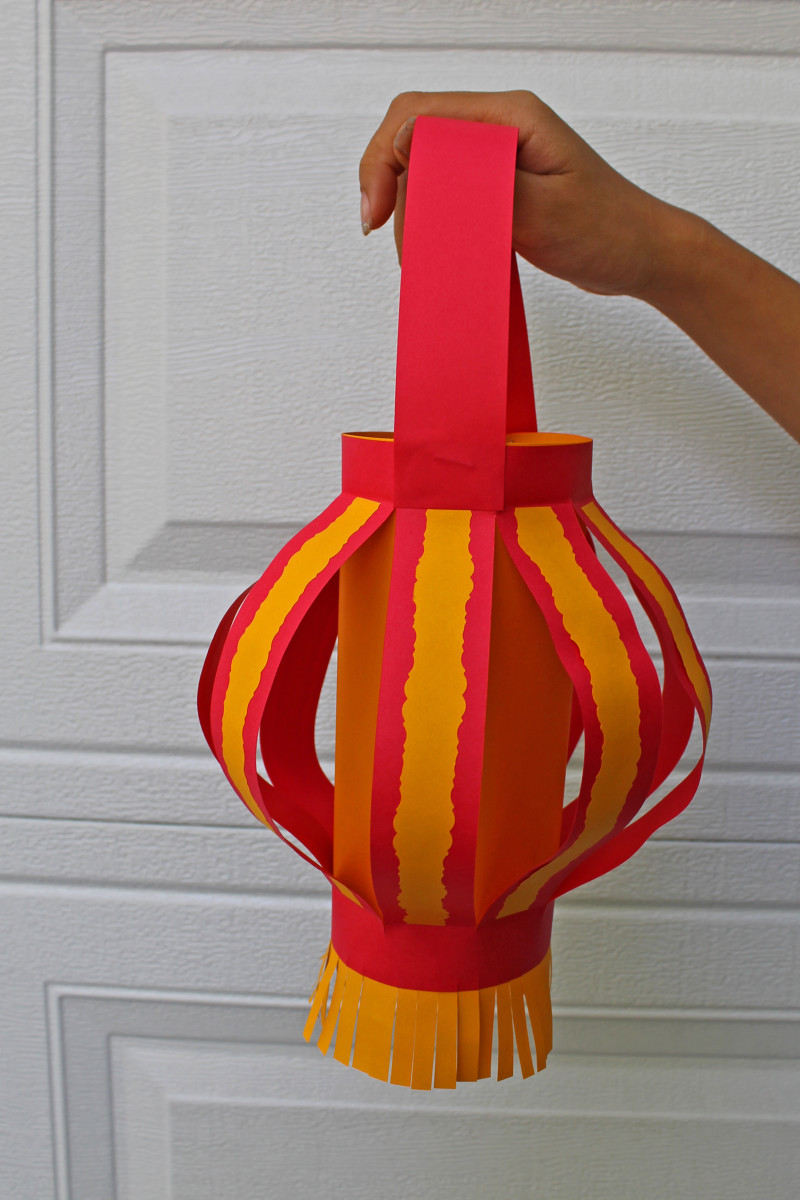 Here the rounded Chinese paper lantern with decoratively-edged paper adorning the lantern's strips.