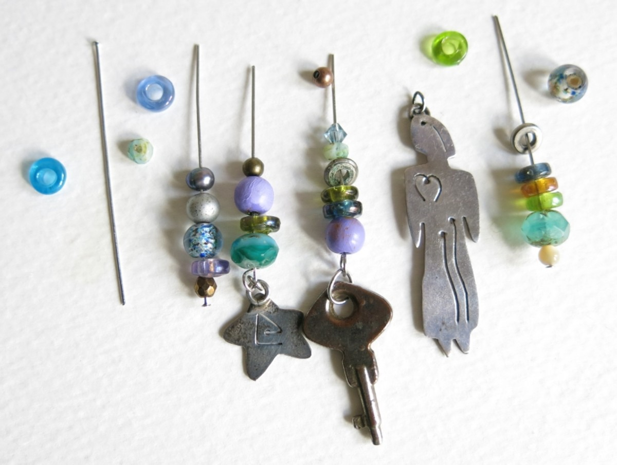Hang beads on head pins to create beaded fringe for a skeleton key necklace