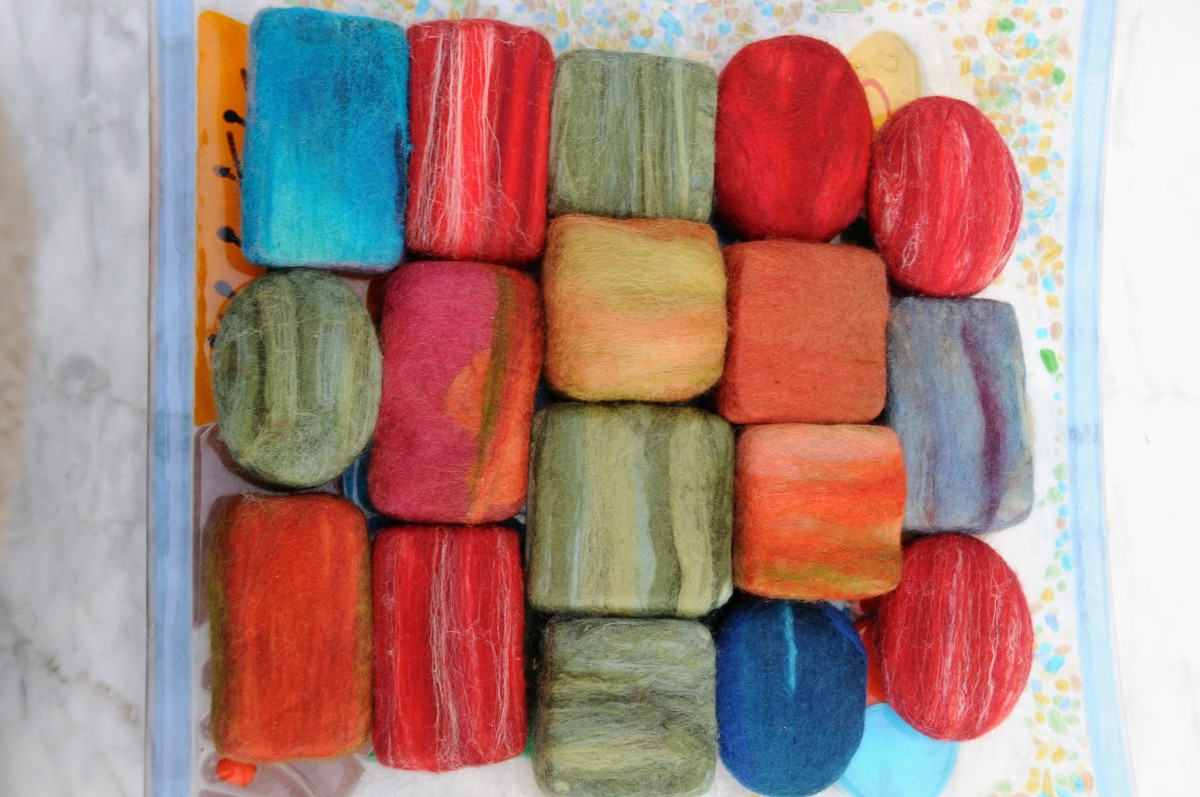 Wet Felted Soaps using a variety of wool including some Merino Wool Roving which includes some Silk Fibre