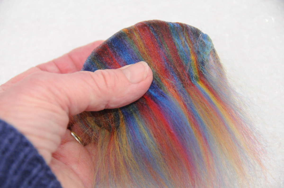 Wrap the fibers firmly around the damp soap