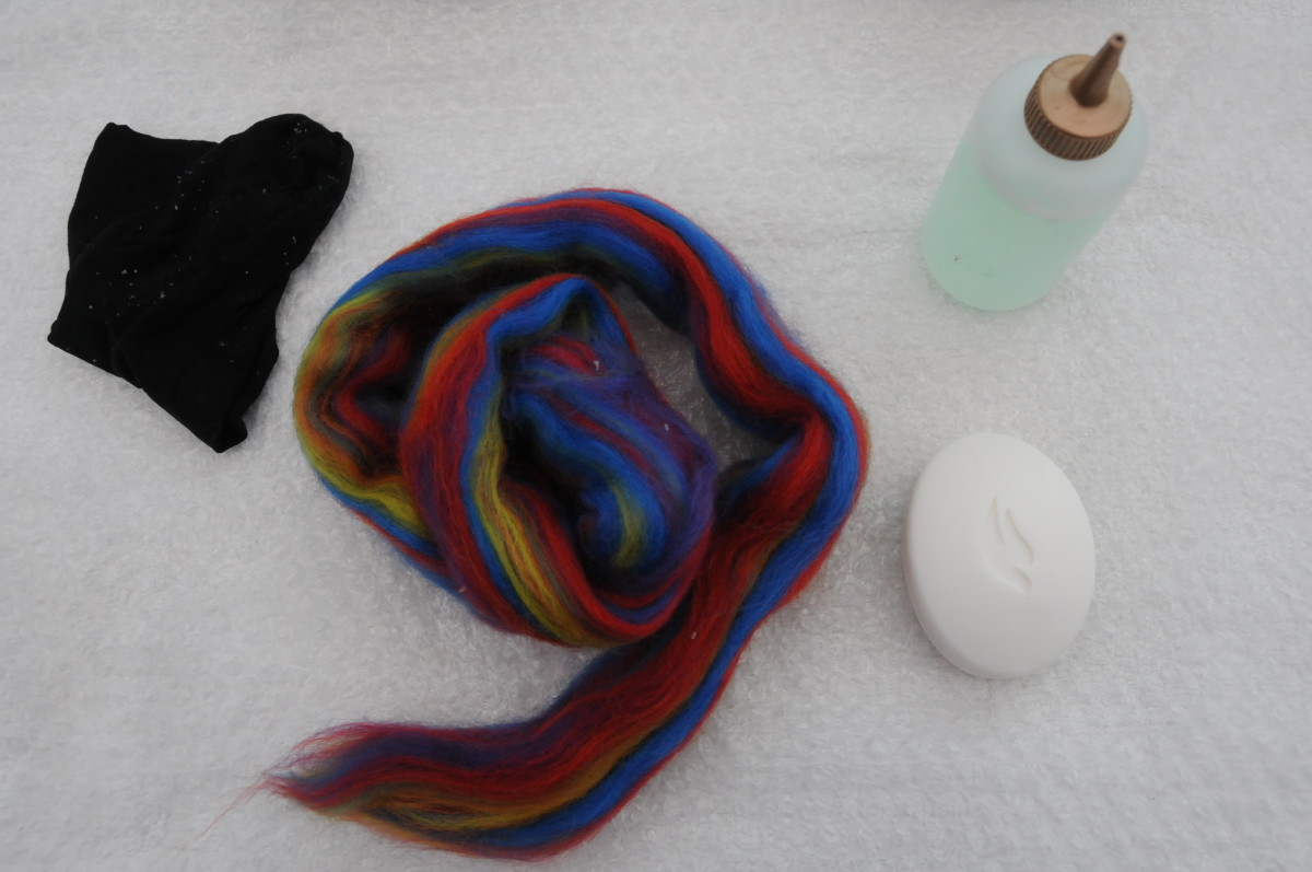 Gorgeous Wool Roving, Soap, cut off Tights and Hot Soapy Water