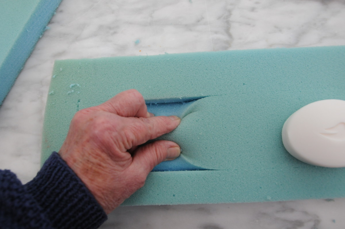 Cut a rectangle into the foam to a dept of about half an inch.  Leave a border of about an inch on all sides.