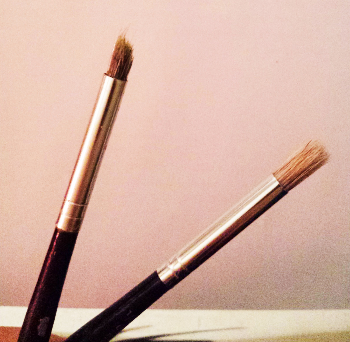 The brush on the left is my favorite brush for applying layers of paint. It gives a nice blend. It looked like the one on the right, brand new. If my fave brush goes kaput, I'll have to wait for the one on the right to become like it. Or find one.