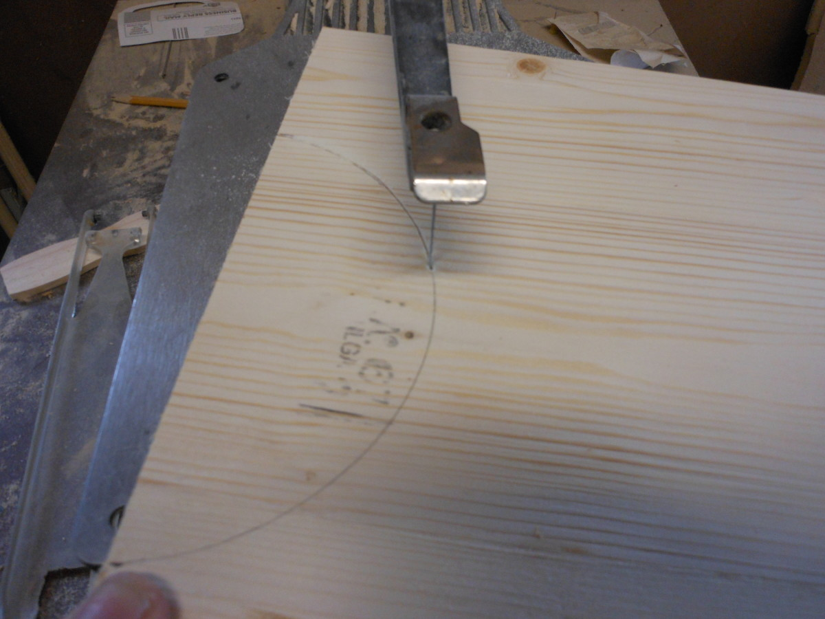 "Cutting the 6"" diameter arc with a scroll saw."