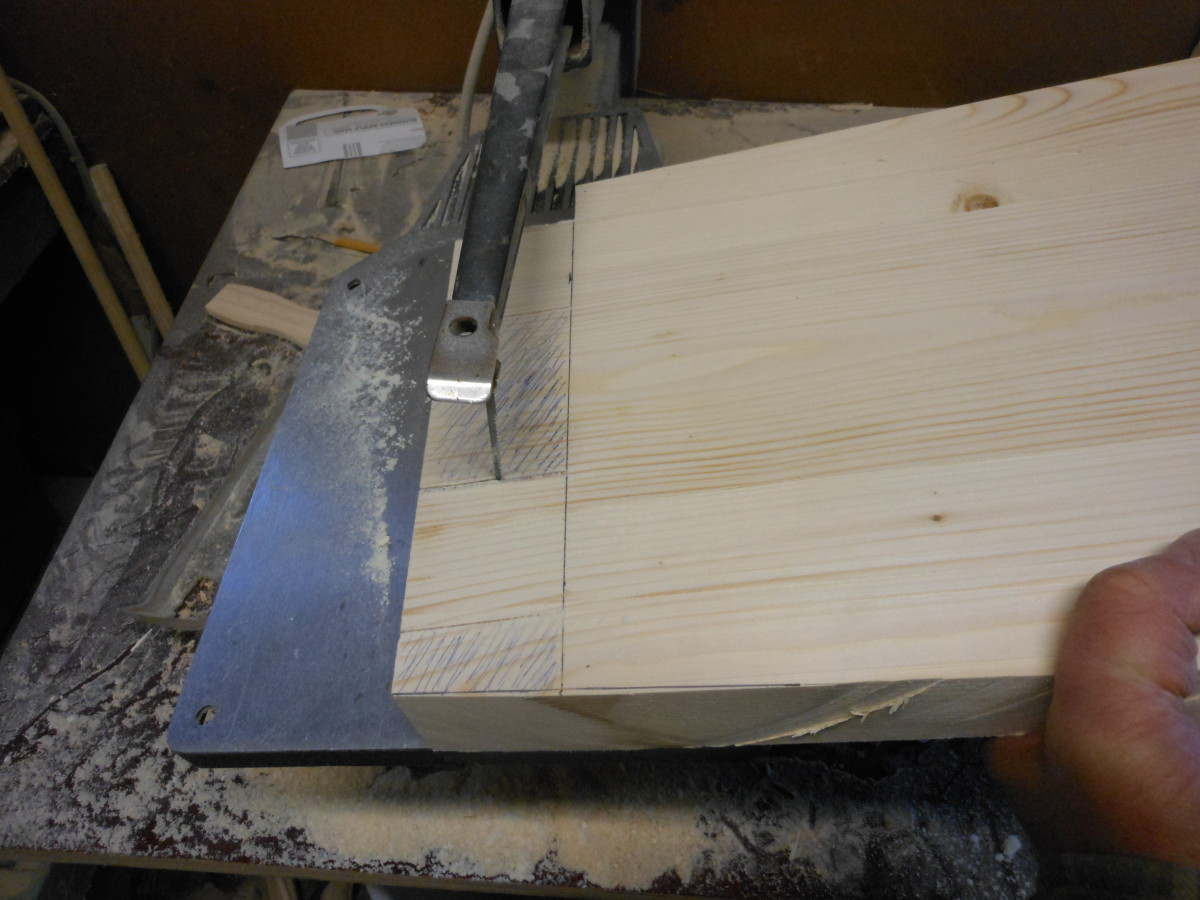 Cutting the tenons on a scroll saw.  To insure a good fit with the joinery, it is a good idea to make the tenons just slightly larger than needed and then shave off the excess wood for a great fit.