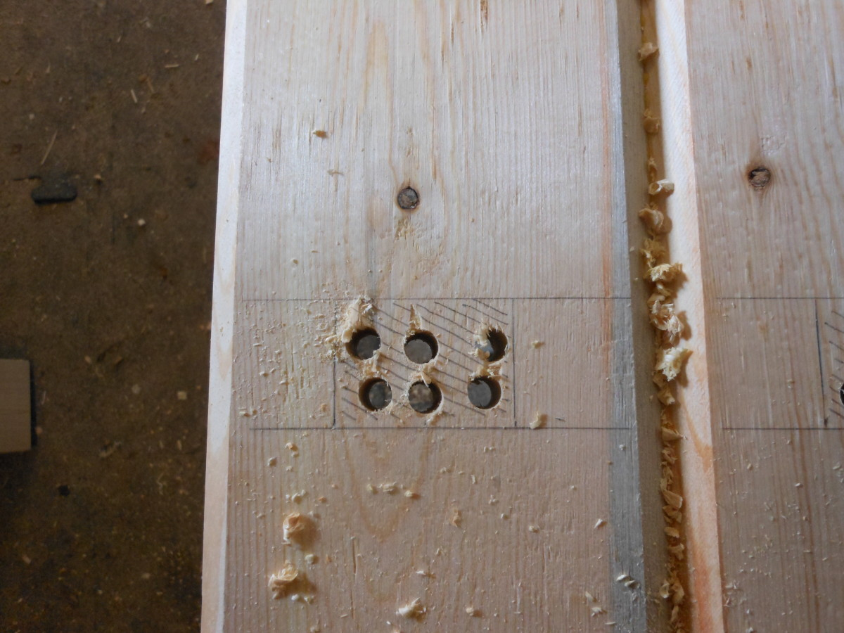 Drill holes in the area to be removed. This makes forming the mortise much easier and quicker.