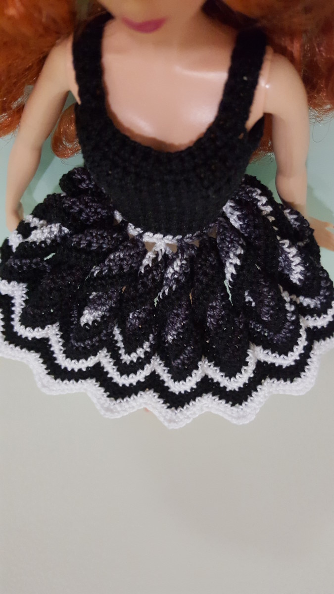 """The skirt """"fully"""" opened. I prefer the skirt to have a smaller opening compared to a full-fledged doily, so the chevron Rounds have decreasing stitch counts instead of increasing."""
