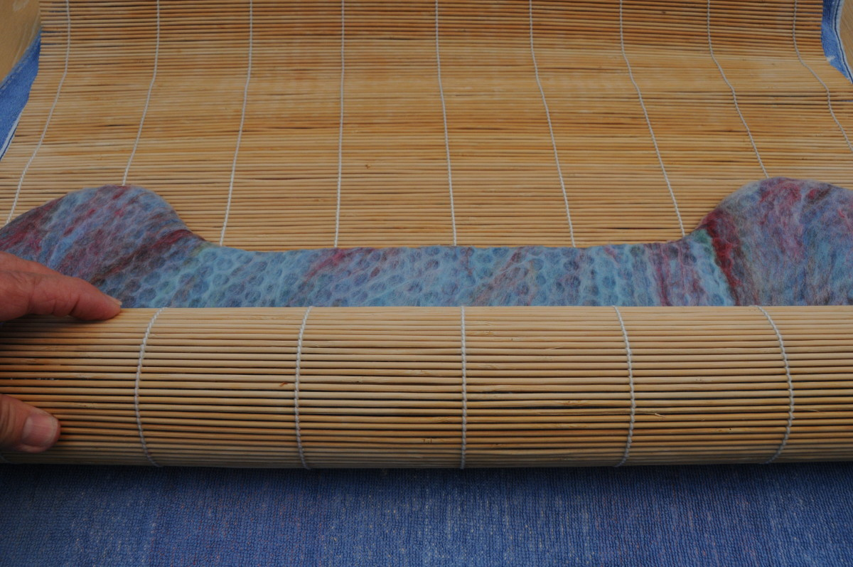 Roll up inside a bamboo mat.  Change the direction in which you roll it, several times as shown in the next images.