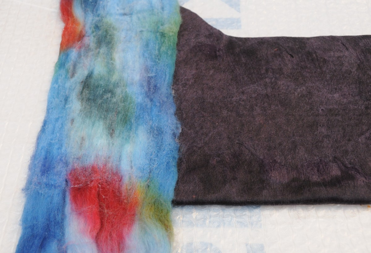 Place the opened up wool roving across the width or the length.  Wet, turn over the repeat on both sides.