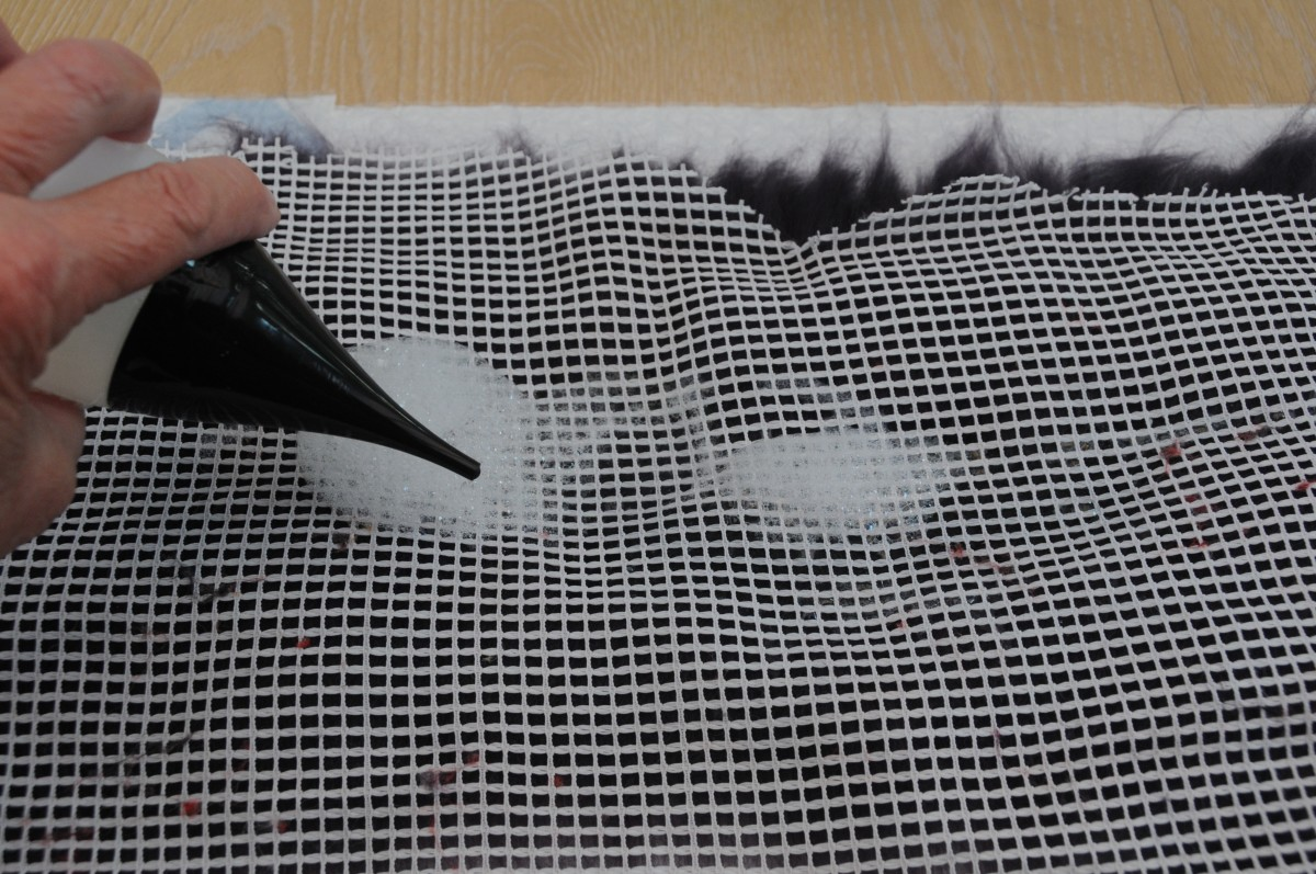 Cover with curtain netting and wet the fibers with warm soapy water.