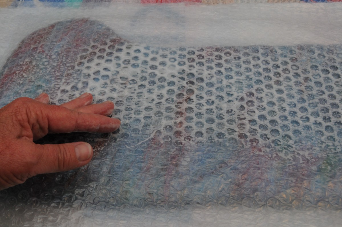 Wet the Bubble-wrap with warm soapy water and rub firmly before the final rolling on a Bamboo Blind.  If no Blind is available rub using the Bubble=wrap. It will take longer.