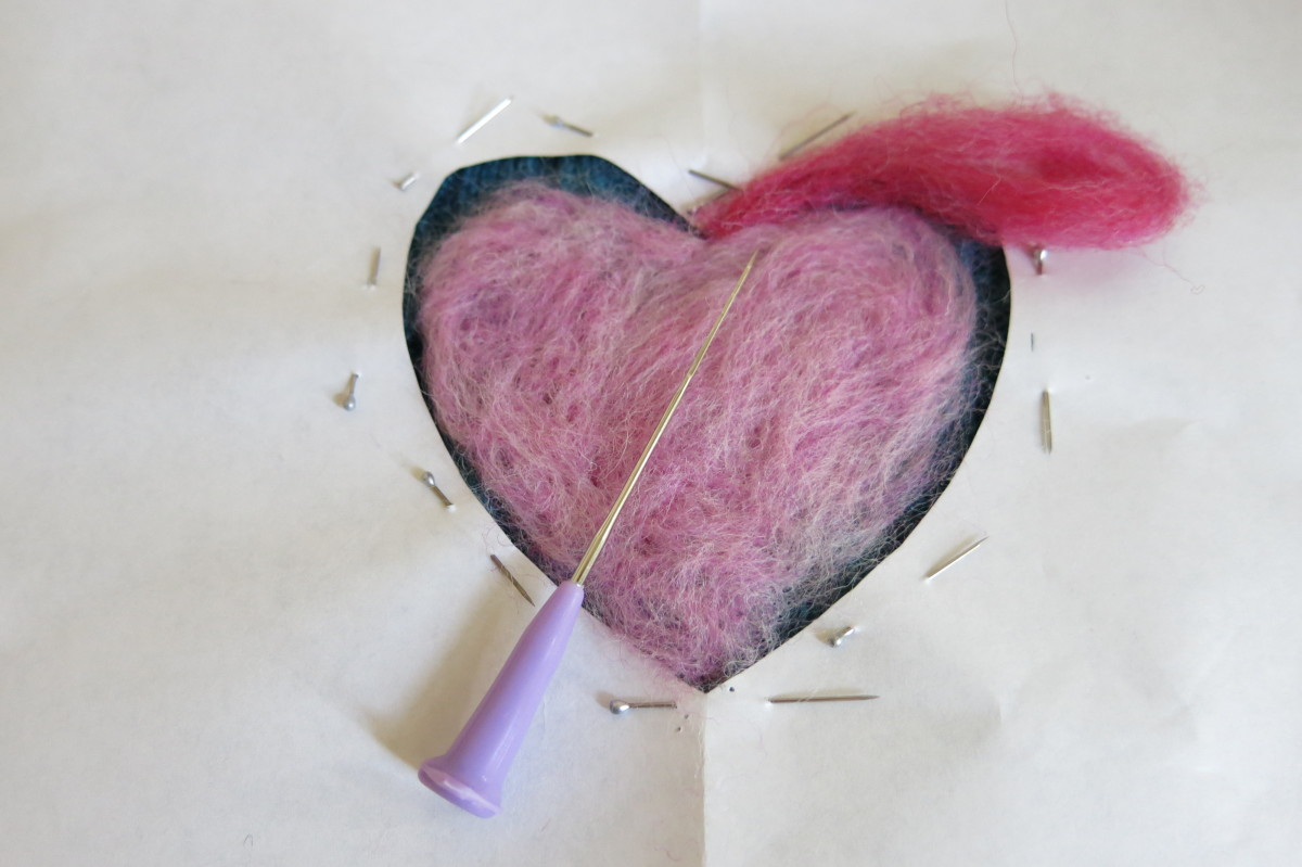 You can use many colors and add details to your design using needle felting.