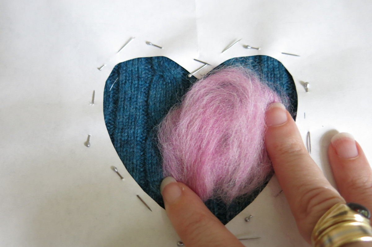 After placing your stencil, you can fill in your design using wool roving.