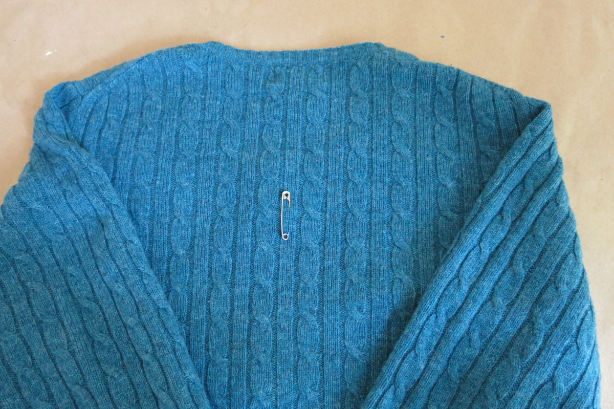 Mark your sweater with the placement of your design for needle felting.