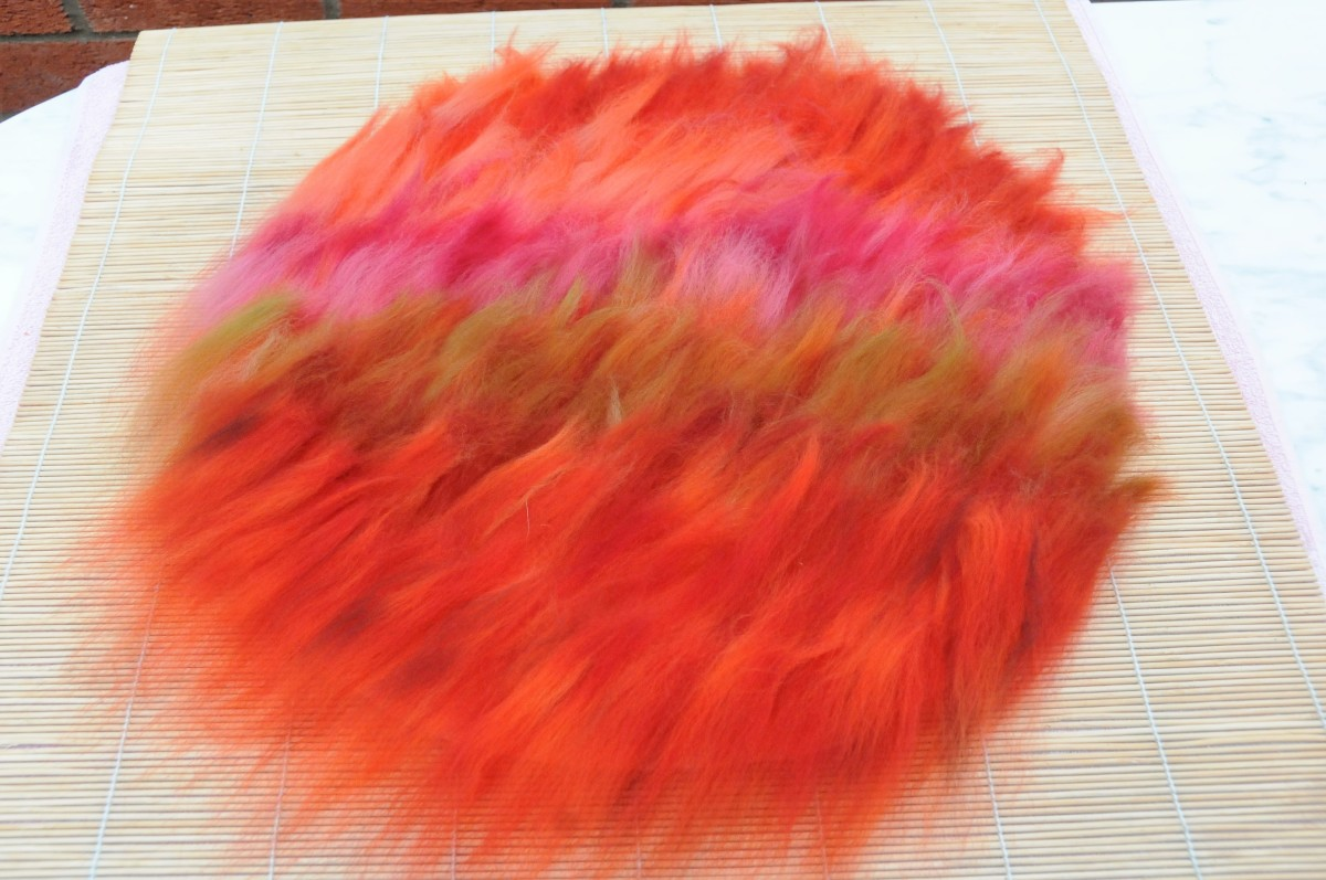 Cover the resist with wool roving.
