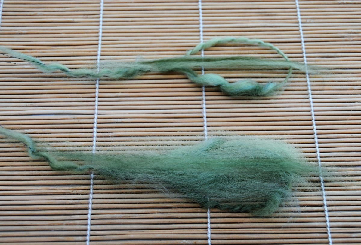 Filling the center of the leaves with green wool roving.