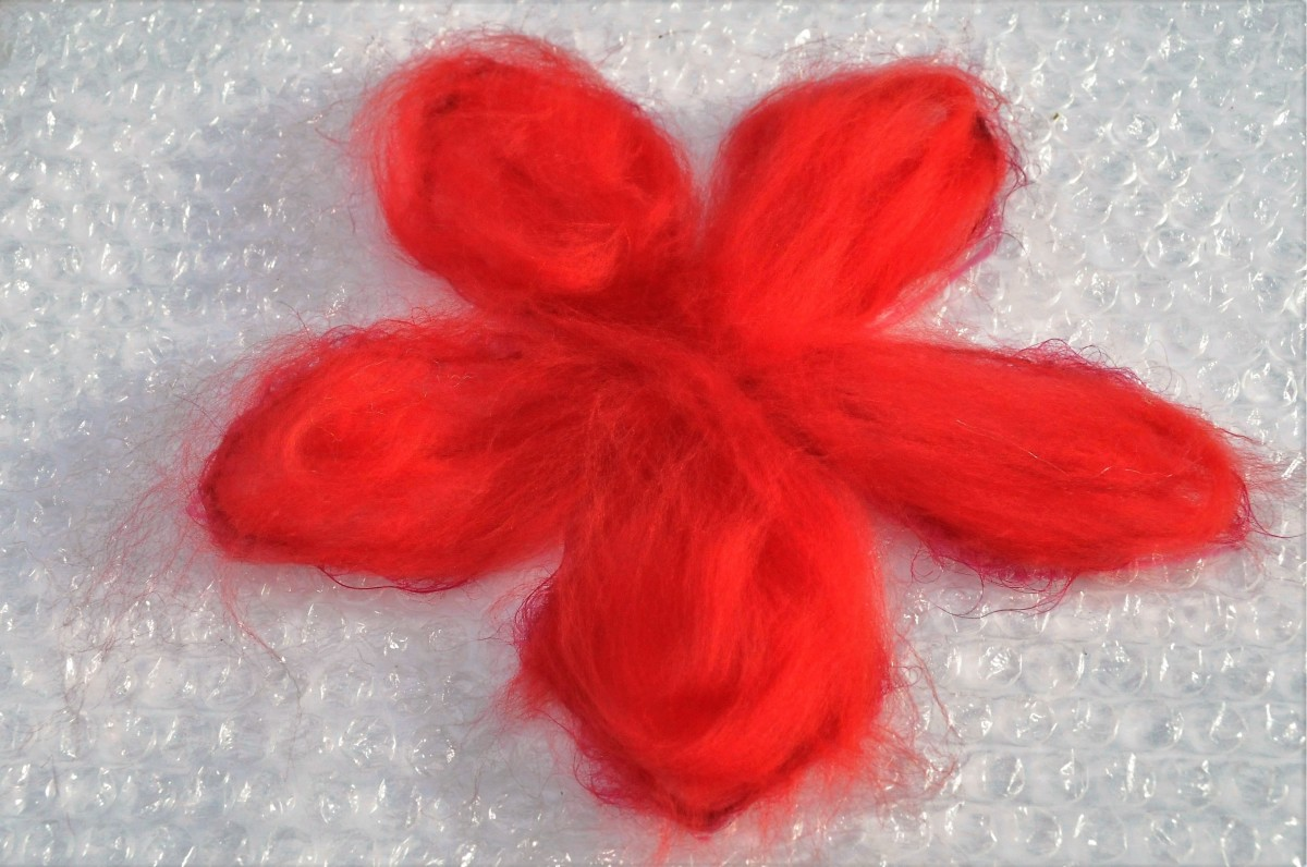 Fill the Petals with Merino wool roving.