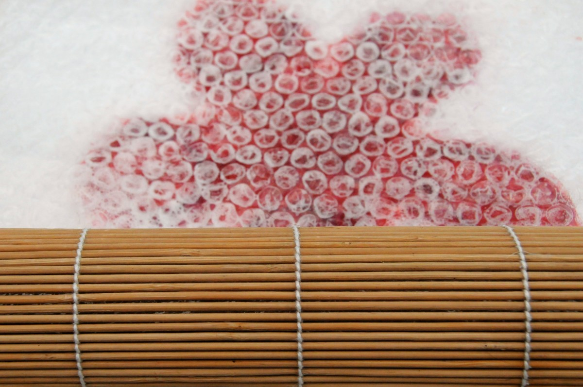 Roll petals inside a bamboo mat, with or without the bubble wrap.